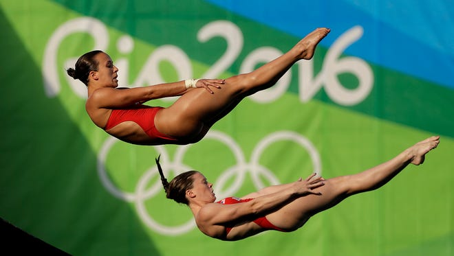 United States' Jessica Parratto, left, and Amy Cozad compete during the women's synchronized 10-meter platform diving final in the Maria Lenk Aquatic Center at the 2016 Summer Olympics in Rio de Janeiro, Brazil, Aug. 9, 2016.
