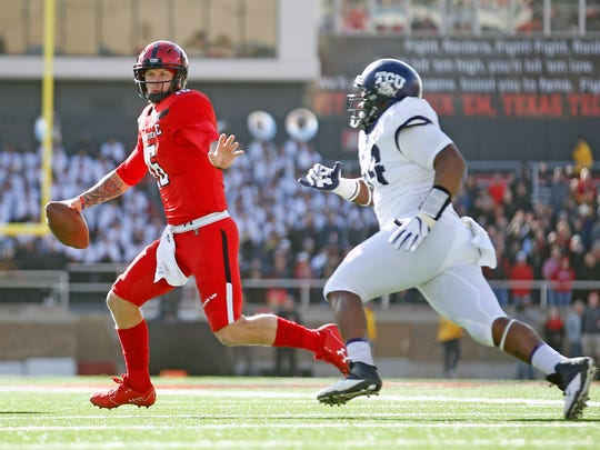 Texas Tech's Nic Shimonek (16) runs away from TCU's Joseph Broadnax Jr. during the first half of an NCAA college football game, Saturday, Nov. 18, 2017, in Lubbock, Texas. (AP Photo/Brad Tollefson)
