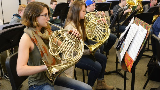 Maddie Pettine rehearses on the French horn in Wind Symphony class at Fossil Ridge High School on Wednesday, March 22, 2017.