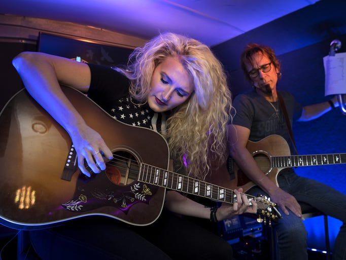 Songwriters Paulina Jayne and Trey Bruce perform on