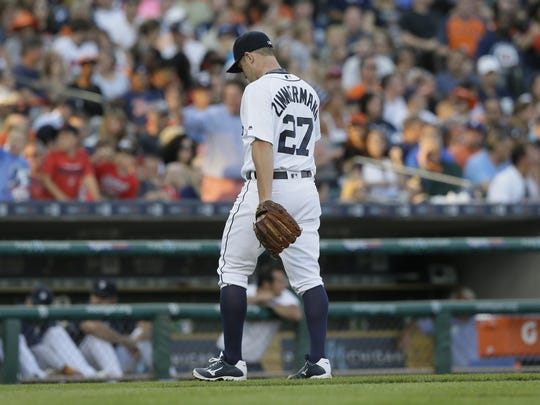 Tigers pitcher Jordan Zimmermann walks to the dugout after being relieved during the fourth inning against the Indians on Friday.