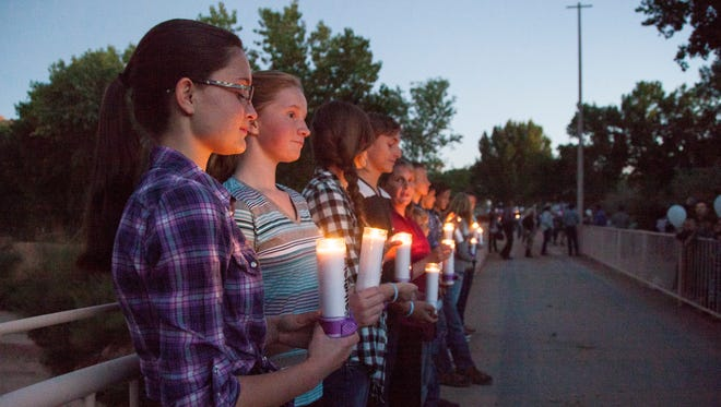 Members of the local community gather at Cottonwood Park in Colorado City to pay tribute to the victims of the Hildale flood Wednesday, Sept. 14, 2016.