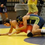 Highly touted Hartland freshman debuts with 2 pins