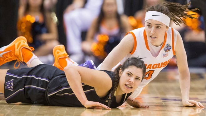 Washington Huskies guard Kelsey Plum (10) (front), and Syracuse Orange guard Maggie Morrison (4) after diving for a loose ball, Syracuse vs. Washington, Women's Final Four, Bankers Life Fieldhouse, Indianapolis, Sunday, April 3, 2016. Syracuse won 80-59.