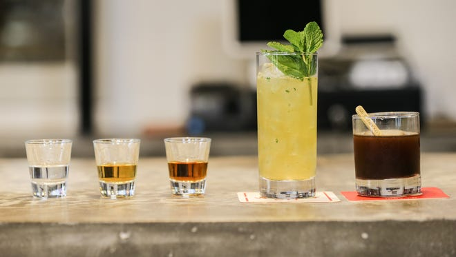 Left to right, 2 Hour Delay corn whiskey, Double Down corn whiskey AKA All or All or Nothing corn whiskey, The Colonel bourbon whiskey, The Whiskey Smash, and a Old Fashion from West Fork Whiskey Co., 1660 Bellefontaine St. in Indianapolis on Monday, Oct. 30, 2017.