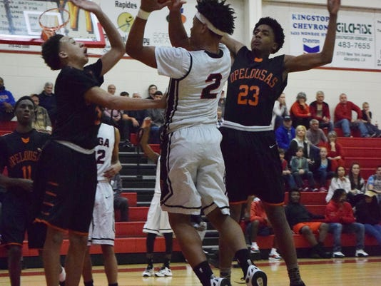 Tioga's Christian Smith (2, center) shoots between Opelousas defenders Roderick Smith (3, left) and Ty Thomas (23, right) Friday.
