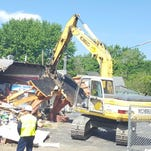 Crews began clearing debris of the Mobil Mart on East Main Street in Ashland  on Friday. A May 3 early-morning explosion destroyed the convenience story building. The State Fire Marshal's Office is still investigating the cause of the explosion.