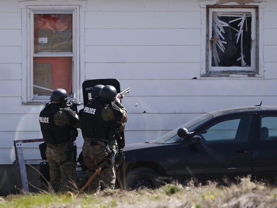Police officers on the scene of a standoff on North