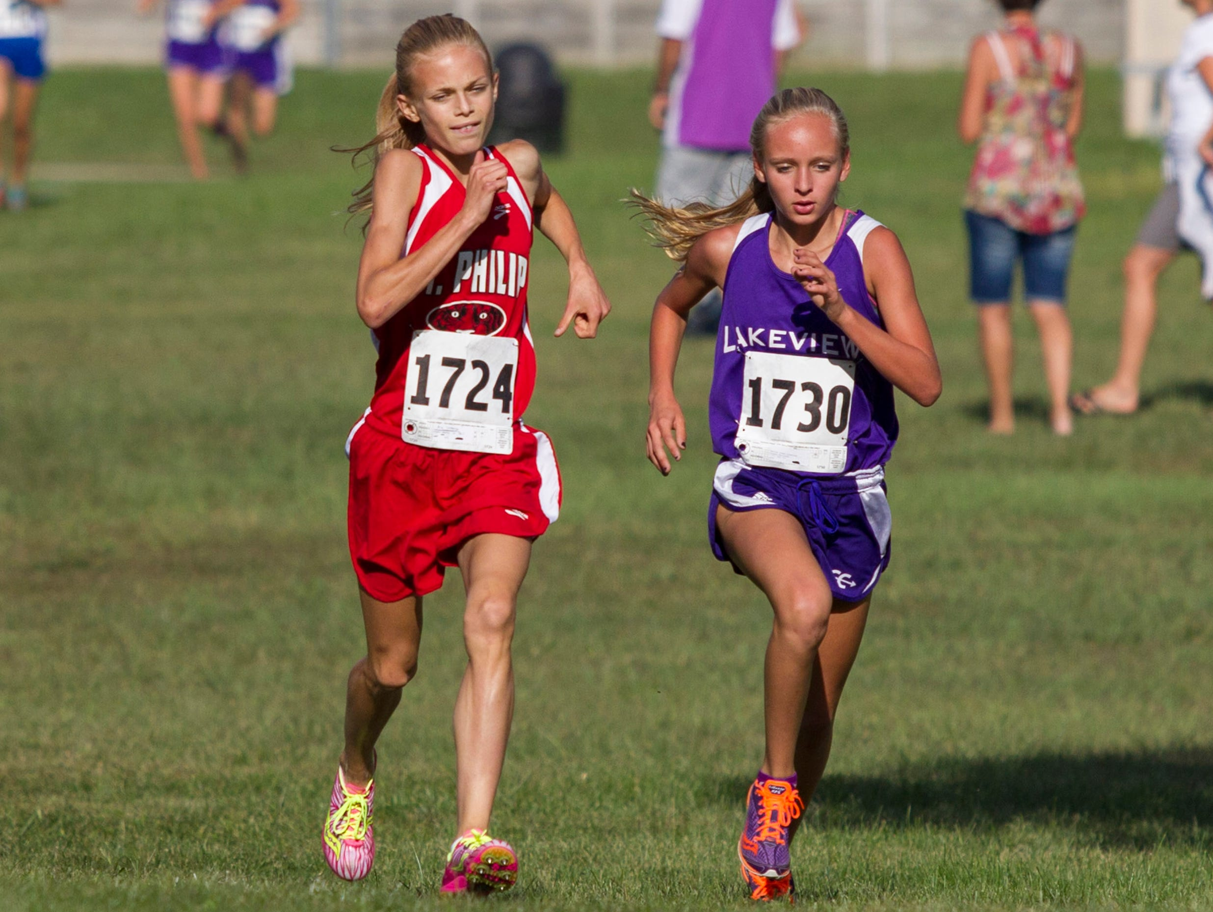 St. Philip's Ava Strenge and Lakeview's Logann Haluszka.