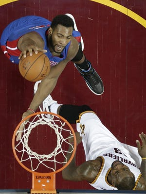 Pistons center Andre Drummond, top, dunks the ball against Cavaliers star LeBron James in the second half of the Pistons' win Feb. 22 in Cleveland.