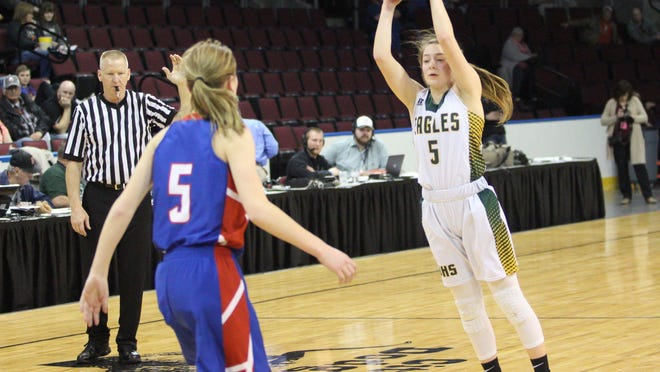 Olpe sophomore Macy Smith (5) jumps to catch a pass in the first half of the Eagles' 2019 state tournament game with Hanover. Smith is one of four returning starters for the Eagles, who went 26-0 last season.