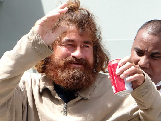 (FILES) In a file picture taken on February 3, 2014 a Mexican castaway who identified himself as Jose Ivan and later told that his full name is Jose Salvador Alvarenga walks with the help of a Majuro Hospital nurse in Majuro after a 22-hour boat ride from isolated Ebon Atoll. A castaway who says he survived 13 months adrift in the Pacific said on February 4, 2014 he thought about suicide but was sustained by dreams of eating his favourite food -- tortillas -- and reuniting with his family.   AFP PHOTO / Hilary Hosia / FILESHILARY HOSIA/AFP/Getty Images