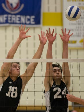 Southern's Shane Bent and Liam Maxwell prepare to block a Harrison shot during first game action. NJSIAA State Boys Volleyball final at South Brunswick on June 9, 2016.