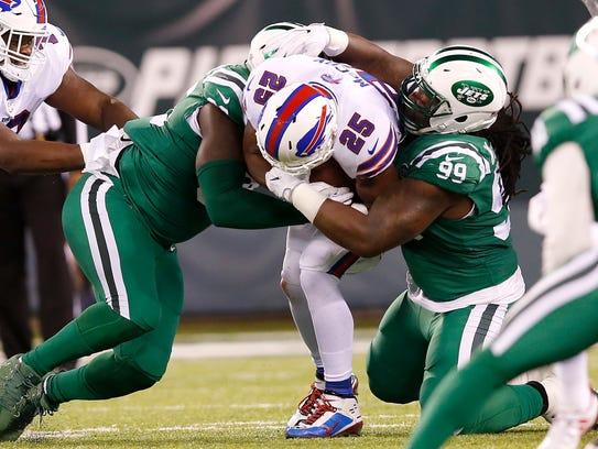 Buffalo Bills running back LeSean McCoy (25) is brought