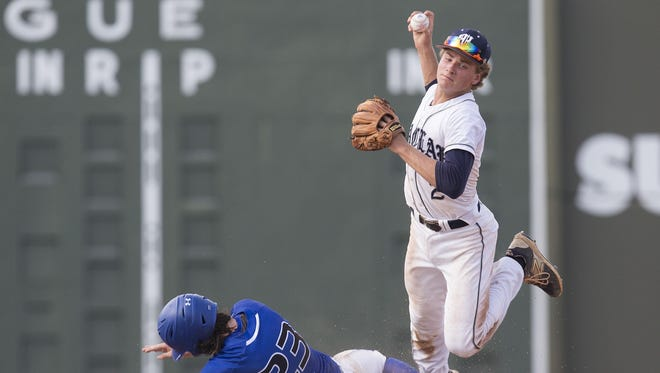 Maclay second baseman Jake Brady is upended by Canterbury's Sam Keating during a FHSAA Class 3A semifinal game between the two teams. Keating was out on the play. Canterbury went on to win 2-1 in extra innings.
