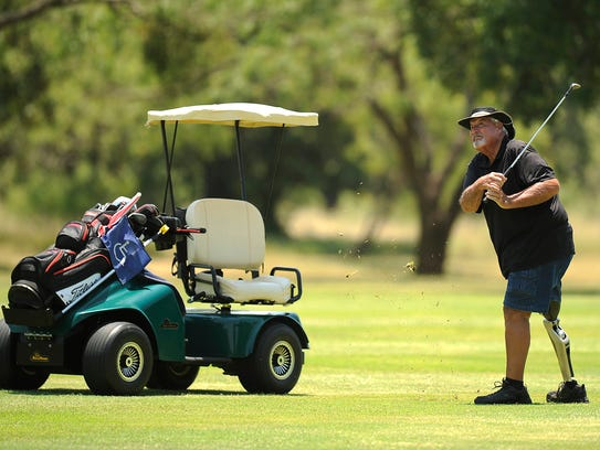 Jerry Drummond, from Manor, hits on to the green on