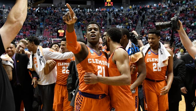 Clemson guard Anthony Oliver II (21) celebrates after Clemson defeated Auburn 84-53 in a second-round NCAA college basketball tournament game Sunday, March 18, 2018, in San Diego. (AP Photo/Denis Poroy)