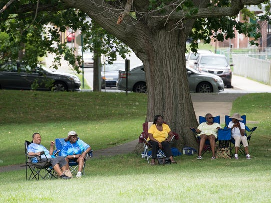 Visitors listen to gospel music during the third annual