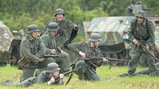World War II Days is one of the best money-making events for Midway Village Museum, which like other museums across the country is struggling financially amid the coronavirus pandemic. Soldiers participate in a battle re-enactment Saturday, Sept. 21, 2019, at Midway Village in Rockford.