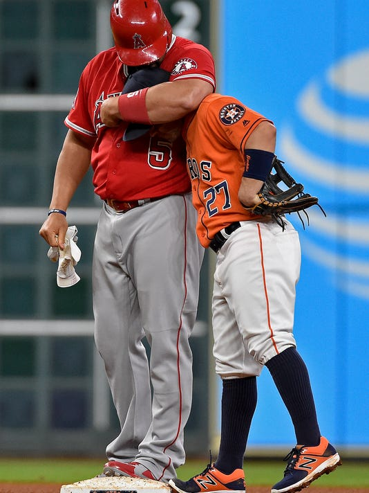 Los Angeles Angels' Albert Pujols, left, hugs Houston Astros second baseman Jose Altuve after hitting a double in the fourth inning of a baseball game, Saturday, Sept. 24, 2016, in Houston. Pujols' double put him at number 15 on the MLB all-time list in doubles, passing Barry Bonds. (AP Photo/Eric Christian Smith)