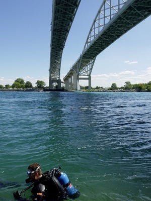A diver prepares to drift in the St. Clair River from the Blue Water Bridge to the Huron lightship.