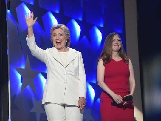 Democratic presidential nominee Hillary Clinton and daughter Chelsea Clinton greet the crowd at the 2016 Democratic National Convention in Philadelphia. Chelsea Clinton is scheduled to appear in Tempe on Wednesday.