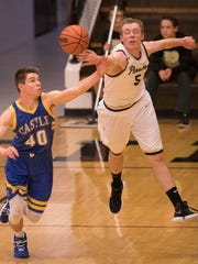 Castle's Triston Wilkinson (40) and Boonville's Glen Rouch (5) battle for the ball at Boonville High School Tuesday night. The Knights beat the Pioneers 77-60.