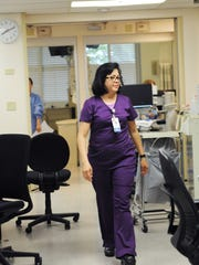 Labindalaua walks through the critical care unit at SVMH on Wednesday morning.
