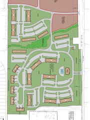 A conceptual site plan of proposed apartments and commercial buildings at the corner of M-59 and Old U.S. 23.