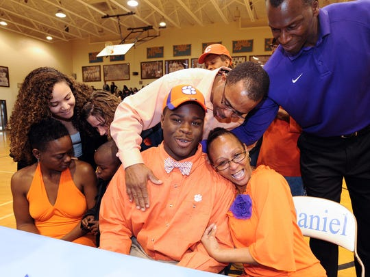 Daniel senior Shaq Lawson is congratulated by his family