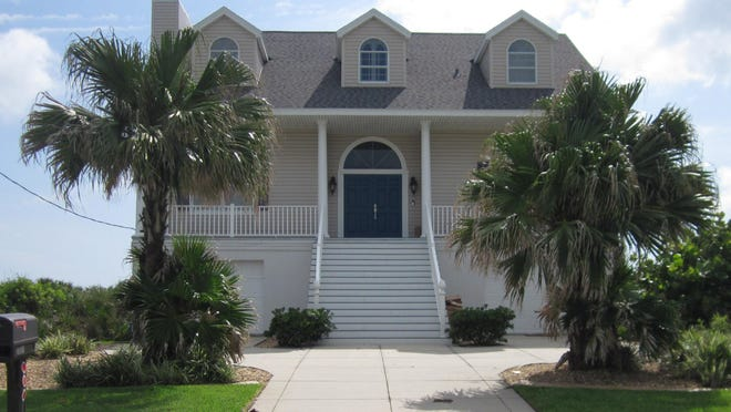 This beachside home on North Oceanshore Boulevard in Flagler Beach has three bedrooms and three baths in 3,139 square feet of living space. It has two master suites, two fireplaces, two balconies and a private beach dune walkover. It was built in 1995 and updated, and it sold recently for $975,000.