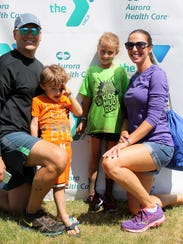 The Schmiedel family poses for a photo at the YMCA