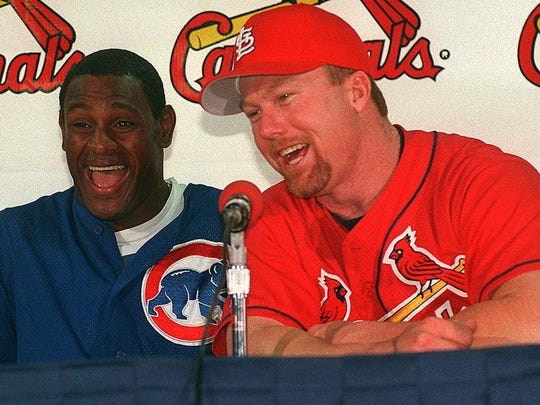 "The Chicago Cubs' Sammy Sosa, left, and the St. Louis Cardinals' Mark McGwire face the media in September 1998. Their rivalry is the focus of ""Long Gone Summer,"" which debuts Sunday on ESPN."