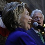 Democratic presidential candidate Hillary Clinton, left, speaks with her husband, former President Bill Clinton at her side during a campaign stop of Irish American supporters at an outdoor midtown Manhattan hotel pub, one day ahead of the New York primary, Monday, April 18, 2016, in New York. (AP Photo/Kathy Willens)