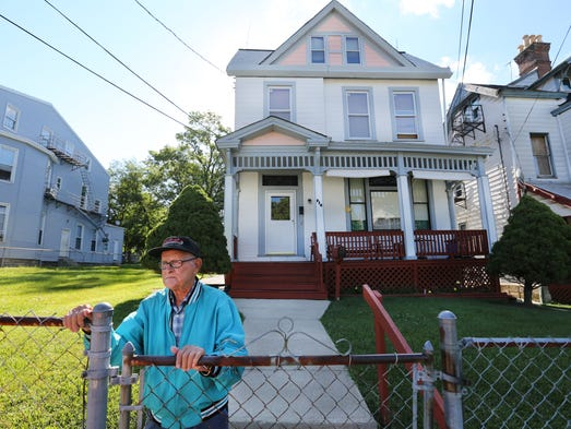 Lawrence Phillips, 85, in front of his East Price Hill home on Hawthorne. Phillips and his wife Ivory, of 68 years, share the home with their son and his wife. Phillips, originally from Sterns, Ky., has lived in this area for 60 years. Certain ZIP codes in Greater Cincinnati and Northern Kentucky, including East Price Hill, could qualify for extra benefits if they became 'economic freedom zones' as envisioned by U.S. Sen. Rand Paul, an Enquirer analysis shows.