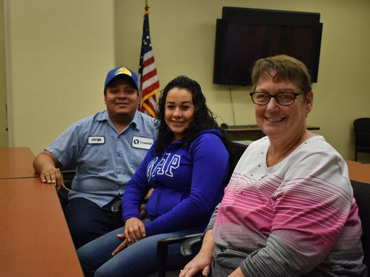 Soon-to-be new Habitat for Humanity homeowners, Jorge and Eleazar Bedolla, with Habitat Family Services Manager Susan Reaves.