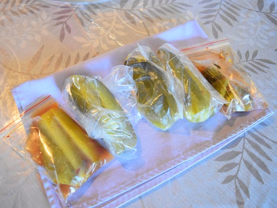 Pickles from five different convenience stores are shown.