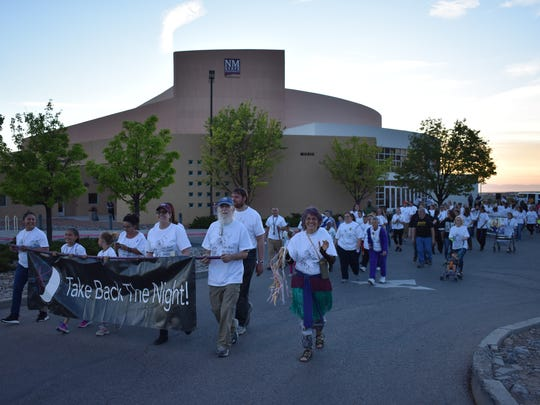 Residents march in solidarity with sexual assault and domestic violence survivors during the 11th annual Take Back the Night event on Saturday evening.