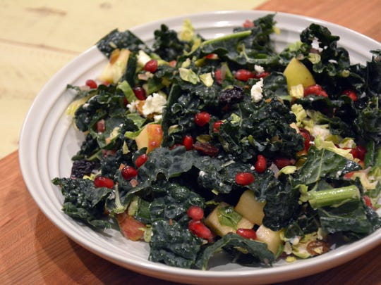 Kale, pancetta, brussels sprouts, pomegranate seeds, apple and goat cheese are a few of the ingredients in this power salad.
