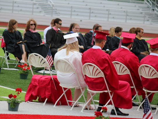 A red gown held a place in honor of the late Devin Kohlman, who died at age 13 due to complications from brain cancer in November 2013, who would have graduated with Port Clinton High School's Class of 2018.