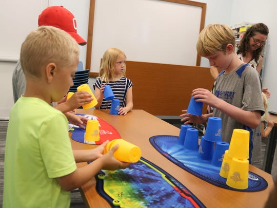 Local children got the chance to try out the sport of cup stacking at the Marblehead Peninsula Branch Library on Saturday.