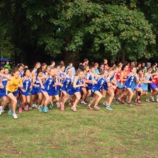 Metro league cross country runners at the start line at a 2013 meet. Ingraham runner RuthMabel Boytz is in the dark blue jersey on the far right.