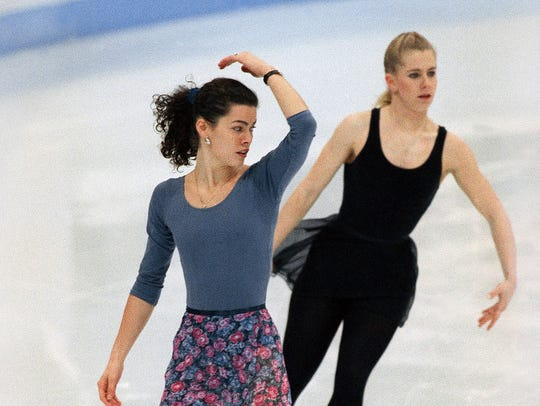 In this Feb. 22, 1994, file photo, American figure skaters Nancy Kerrigan, left, and Tonya Harding work out during an Olympic practice session at Hamar Olympic Amphitheater in Hamar, Norway.