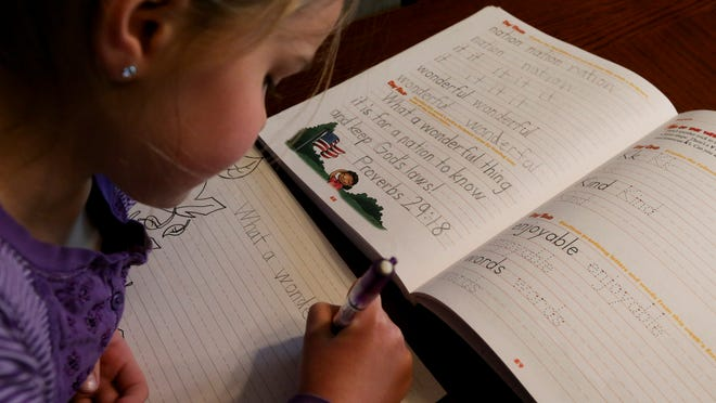 Lydia Crabb, 7, of Ankeny, a home-schooler, practices her handwriting in April 2015.