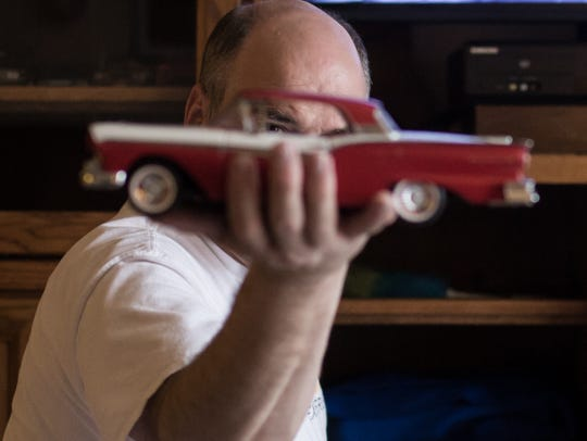 Ron Plewa 46, of Shelby Township shows off one of his