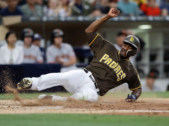 San Diego Padres' Jabari Blash scores on a single by Erick Aybar during the second inning of the team's baseball game against the San Francisco Giants on Friday, July 14, 2017, in San Diego. (AP Photo/Gregory Bull)