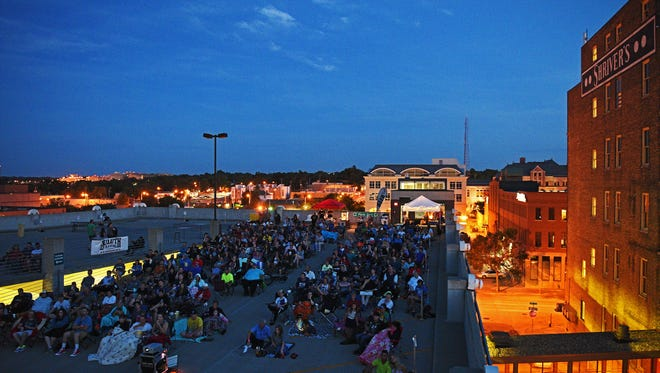 Rooftop Cinema-goers gather on top of the First Avenue parking ramp for a movie during a Rooftop Cinema event Thursday, July 28, 2016, in downtown Sioux Falls.