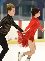 Practicing hand-in-hand at Arctic Edge Arena in Canton are Elliot Verburg and Tish Marsh.