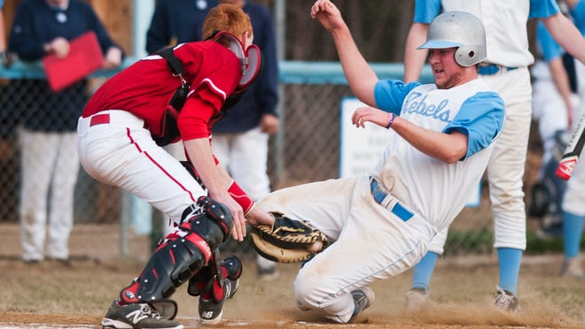 Champlain Valley catcher Shea Ireland (left) tags out South Burlington's Ryan Burt at the plate during Thursday's game in South Burlington.