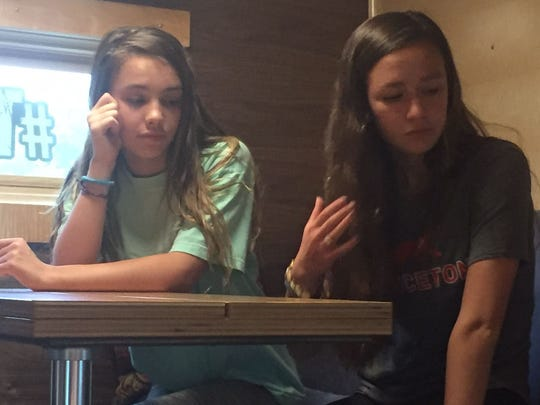 Remy Stewart (left) and Annabel Teague (right), both 8th graders at the Wilmington Friends School tour the Lunsford's tiny house that visited their school on Friday.